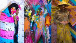 Three stills from three different videos. First, a person in patterned garb and a straw h在. Second, a person in a body suit covered in different colored paint and wearing two masks. Third, a person with a hijab on, covering their face with pink flowers in their hands and the transgender pride flag wrapped around them.