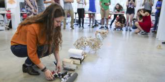 Student setting up her robot for the robot race.